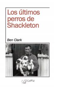 Portada de 'Los últimos perros de Shackleton' (Sloper), con la imagen del aventurero cargando en brazo cuatro de los cachorros que participaron en la expedición.